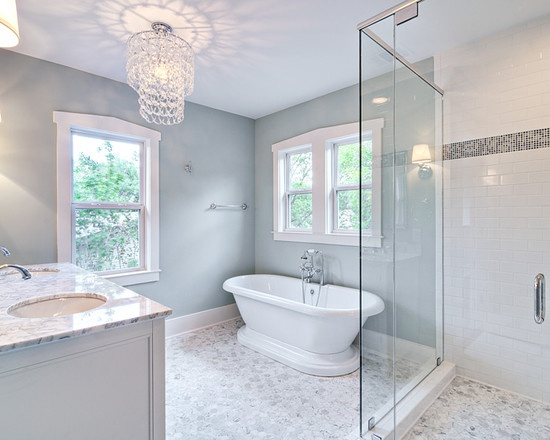 Pic Of Spa like master bath with glass chandelier and pedestal tub traditional bathroom austin Avenue B Development