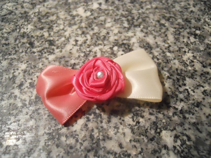 Barrette with Hot Pink rolled rose and Peach/Ivory satin bow. Placed on an alligator clip and lined with satin.     Price: $8  Shipping: Send Message    http://www.facebook.com/CandysCoutureCanada    Handmade by Candy's Creations.