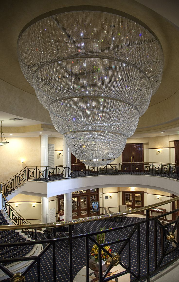 Custom #designer #lighting for an interior lobby by Diemme. #Chandelier #crystals #glass