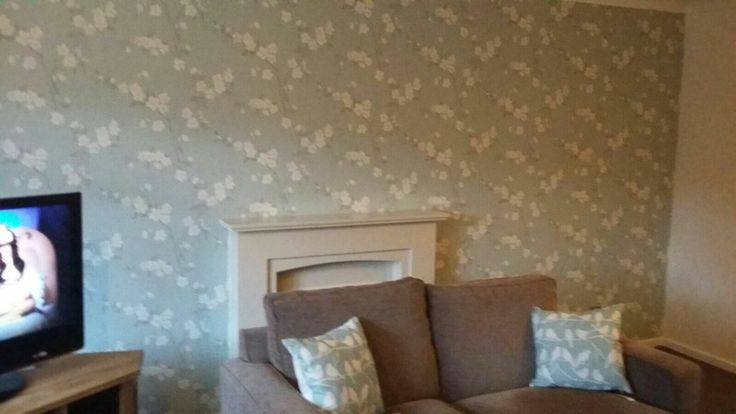 My living room wallpaper,  john lewis cherry blossom. Paint drying hence couch in middle of the room