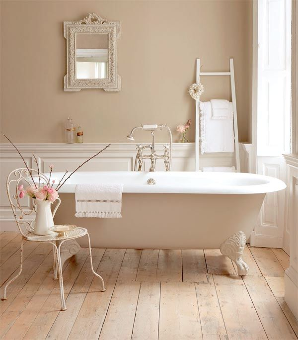 I love this! What a beautiful and dainty look for a bathroom! I love the antique look, the country charm, and the cool feeling of it. I love old-fashioned tubs like this on light hardwood floors, tall windows, and light fixtures and wall colors. I wish it was in a lavender or light blue color, though...