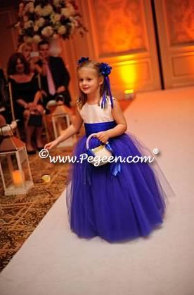 Flower girl dresses for a wedding with awesome colors in royal purple and blue sapphire ~ Located 1 mile from Disney World, Selling online and shipping world wide. Call us for design help! 407-928-2377