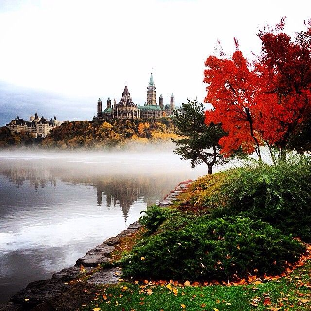 The morning fog rolls off the Ottawa River below Parliament Hill.   For more information, visit www.ottawatourism.ca
