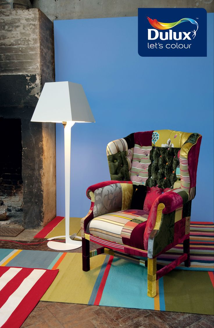 This Colourful Armchair And Carpet Brings A Quirky Flare To An Otherwise Boring Living Room