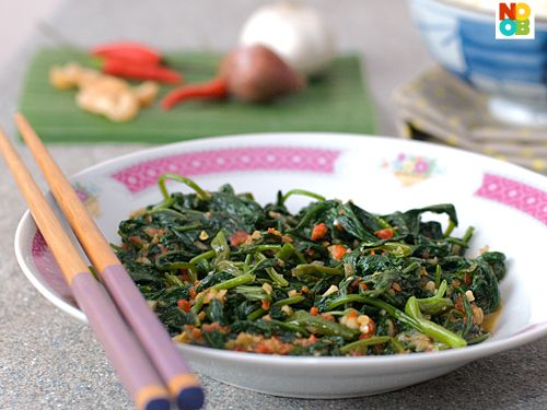 Easy recipe for kangkong (kang kung) stir-fried with sambal chilli, a South East Asian local delight.