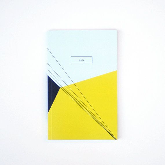 I'm staring a collection of pretty 2014 calendars for an upcoming Design Ideas. Please feel free to share calendars and planners that design-minded people might like. 2014 weekly planner  skyline by dozi on Etsy, $27.00