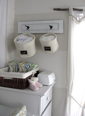 Hang diaper baskets above changing table with little surface space
