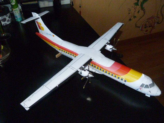 This airplane paper model is an Air Nostrum (aka Iberia Regional) ATR 72-600, a variant of the ATR 72, which is twin-engine turboprop short-haul regional a