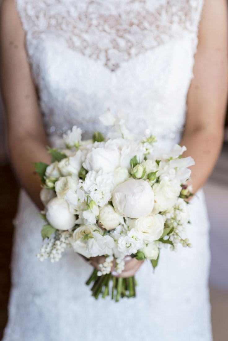 Love this combination of lace detailing and delicate white flowers from Jess & Matt's wedding