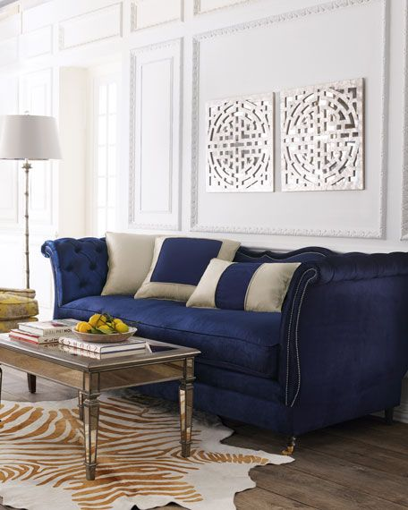 #ONLYATNM Only Here. Only Ours. Exclusively for You. Classic curved sofa. Alder-wood frame. Navy blue cotton/rayon velvet upholstery. Coordinating accent pillows as shown. Finished with petite nailhea