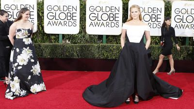 I couldn't pin the image for some reason, but this site had the only pic I've been able to find showing the BACK of Amy Shumer's Golden Globes 2016 dress.