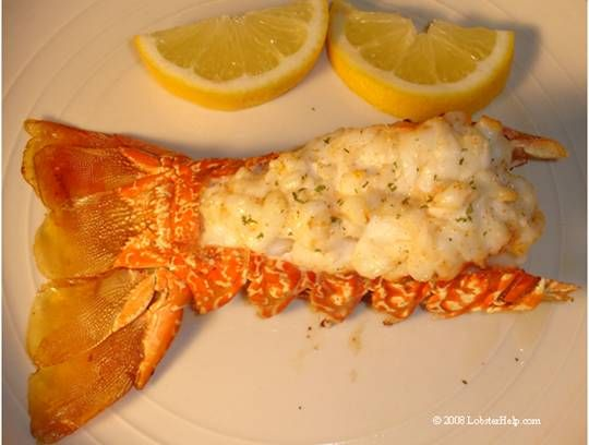 My ultimate culinary delight - broiled lobster tail with clarified butter and lemons.  Yummm !
