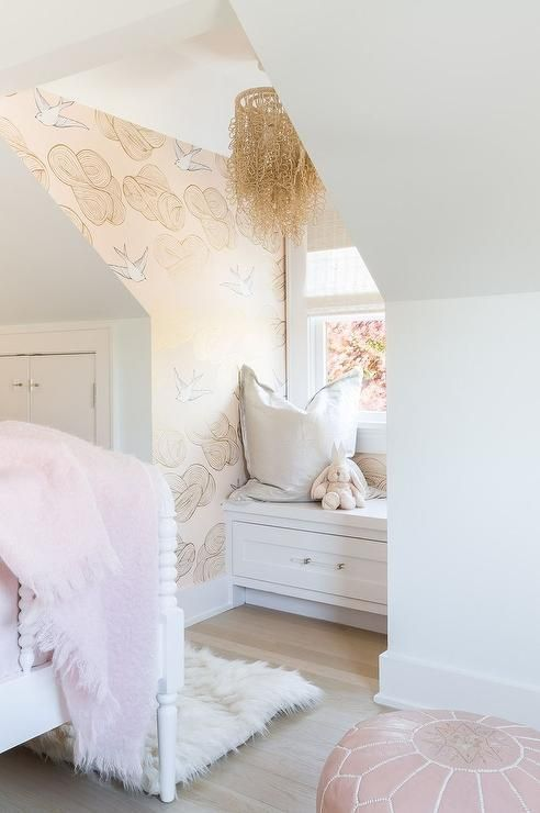 Charming gold and pink girl's bedroom is fitted with a window seat nook that's clad in Hygge & West Daydream Wallpaper   Alyssa Rosenheck - Raquel Garcia Design
