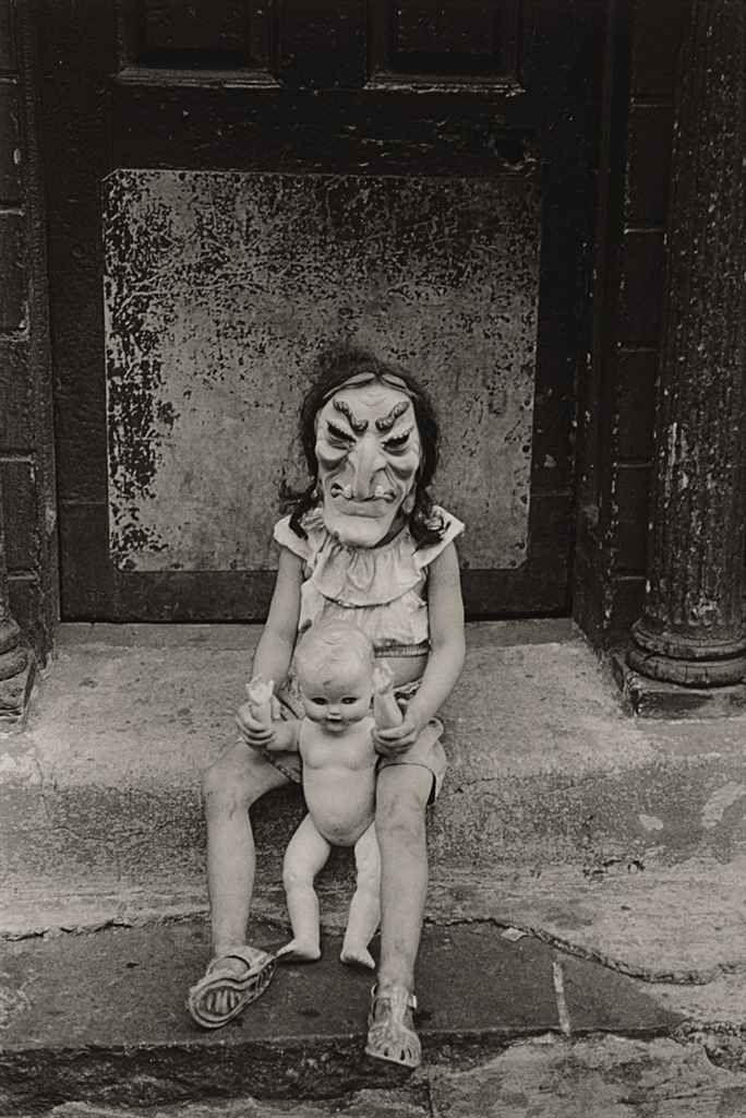 Masked Child with a Doll, 1961  photo byDiane Arbus #Photography