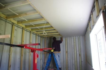 prefab build shipping container house attaching plasterboard to ceiling