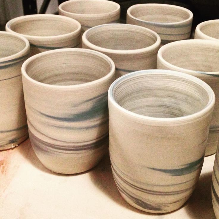 Making mugs! 34 on the way to being done and now creamers to go #CafeIsthmus #commission #makingprocess #wheelwork #layeredclay #colouredclay #TaskersCafé #handmade #tumblers #coffeetime #australianceramics #customdesign #homewares #porcelain #agateware #neriage #marbledclay #nerikomi #wheelthrown #ceramics  #pottery