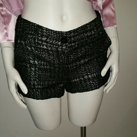 Express Black Silver Shorts Express Black Silver Shorts Cute, very chic and flattering short for you.  Will fit small and extra small Express Jackets & Coats