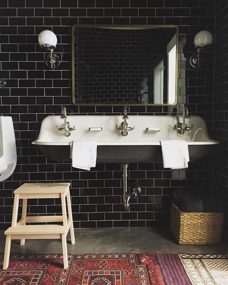 black subway tile* spacious sink* antique patterned rugs*