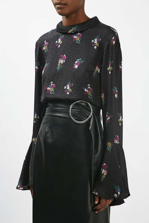Opt for elegant florals to add an air of sophistication to your outfit. This printed jacquard blouse comes with a flattering funnel neck, tie-back detail and pretty flared sleeves. Style it with a leather skirt for an edited finish. #Topshop