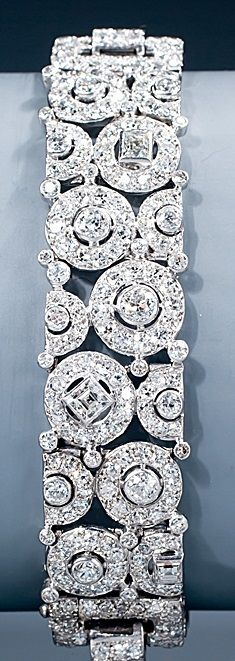 A magnificent Art Deco diamond bracelet by Cartier. Of an unusual geometric design of circles and squares, set with baguette-, square-, single- and old European-cut diamonds, mounted in platinum, Paris, circa 1928-1930, signed CARTIER and numbered, French assay mark for platinum. #Cartier #ArtDeco #bracelet