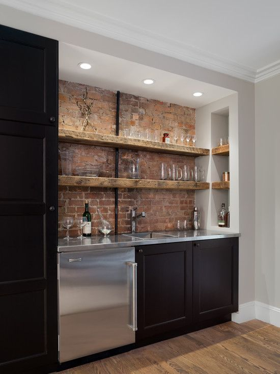 ... With Backsplash And Sink Also Various Glass In Cabinets And Brick Wall