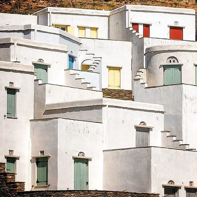 This place called Ag. Romanos , in Tinos island (Τήνος) ☀️. Magical sample of Cycladic architecture of white houses and colorful windows & doors ❤️.