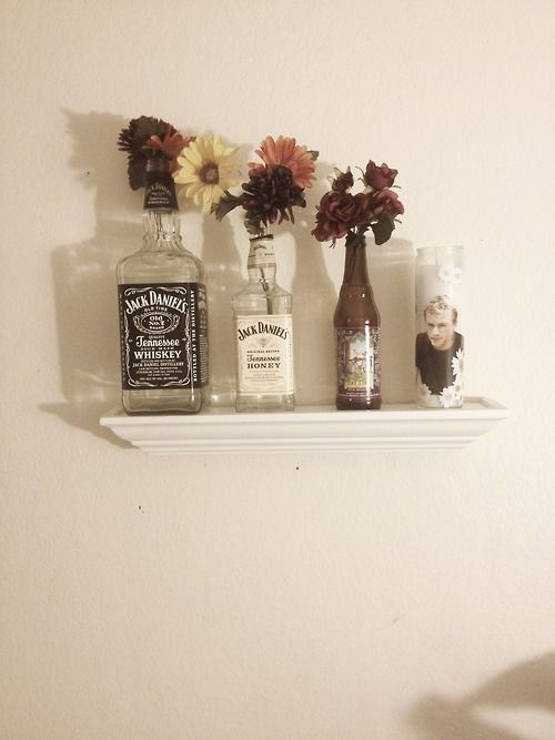 Jack Daniel's bottles as vases, and the one on the far right has Heath Ledger. I'm so in love with this
