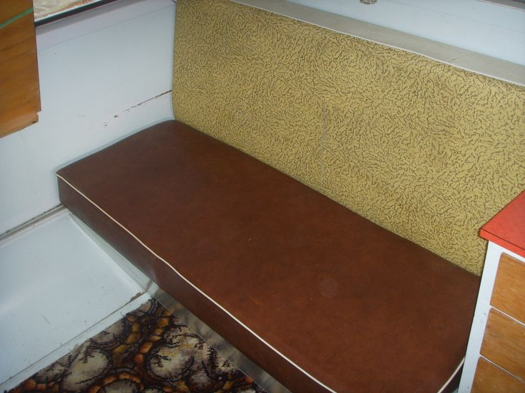 Pre-reno. Interior Seating, gold upholstery original, brown vinyl and carpet added in later.