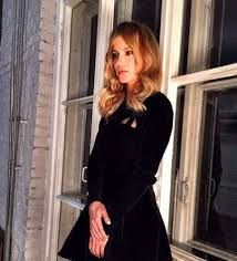 Cute choice of modern style black dress for Victoria Beckham