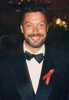 Tim Curry. He's got such an amazing smile. He's glorious!