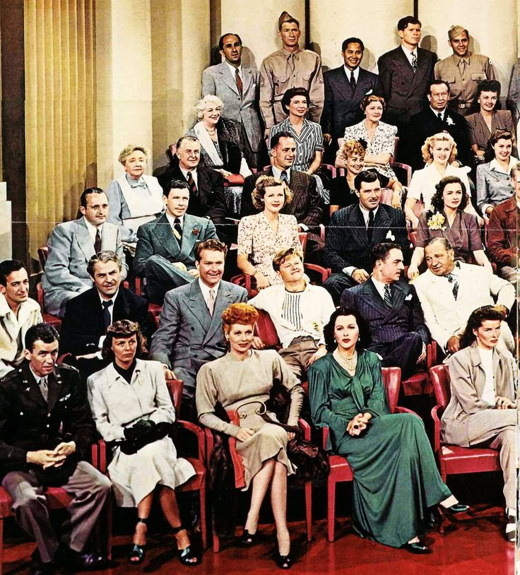 A group photograph of MGM's stars and starlets under contract, taken for the studio's 20th anniversary in 1943. James Stewart, Margaret Sullavan, Lucille Ball, Hedy Lamarr, Katharine Hepburn, Harry James, Brian Donlevy, Red Skelton, Mickey Rooney, William Powell, Wallace Beery, Tommy Dorsey, George Murphy, Jean Rogers, James Craig, Donna Reed, Dame May Whitty, Reginald Owen, Keenan Wynn, Diana Lewis, Marilyn Maxwell, Esther Williams, Blanche Ring, Sara Haden, Fay Holden, Bert Lahr, Frances…