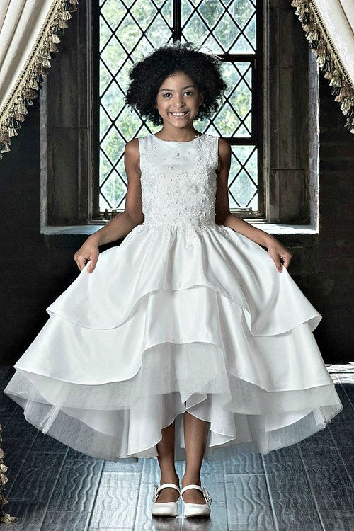 f898a794627 She will create unforgettable memories in this beautiful Macis Couture communion  dress. She will twirl