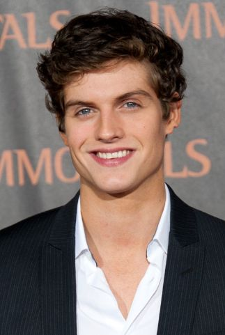 Daniel Sharman. If he wasn't already perfect enough, he's dating my favorite person Crystal Reed.