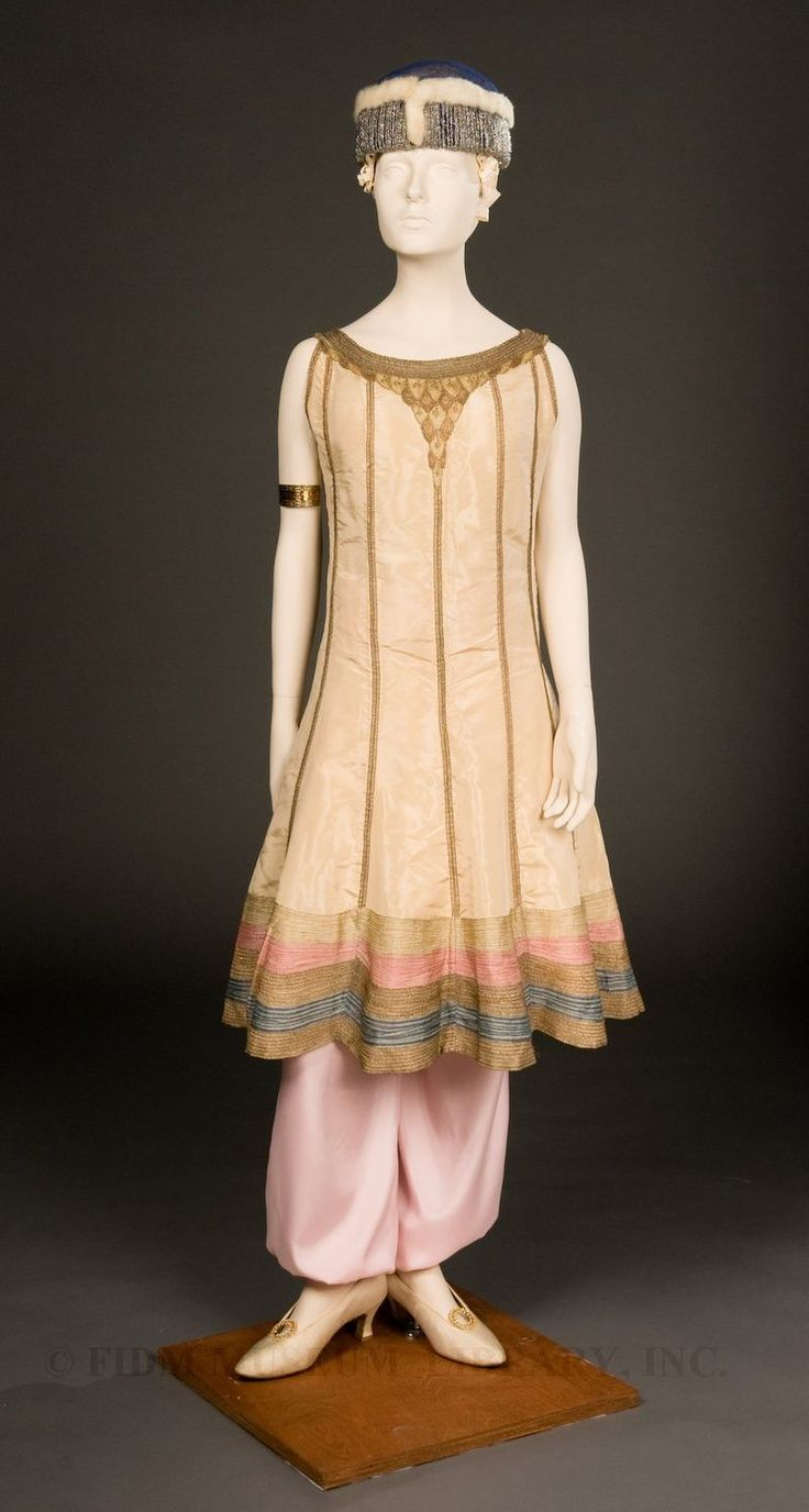 """Paul Poiret. circa 1913. In 1911, Poiret introduced """"jupe-culottes"""" or harem pants. These full pants fell together almost as a skirt would and were worn under a tunic. This style was popular, primarily among womenwith bohemian tendencies, as most women did not yet wear pants on a regular basis.The same tunic could also be worn over a skirt, a style much more acceptable to the general public. The fashion press dubbed this the """"Persian silhouette,"""" in recognition of itssupposed origins."""
