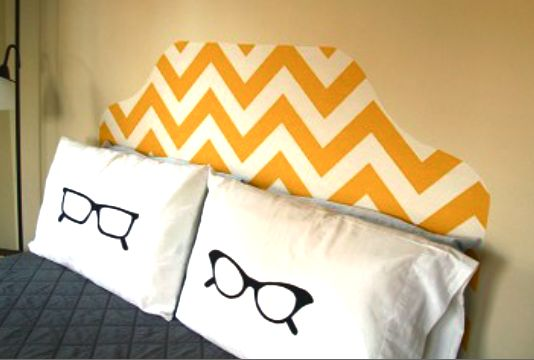 fake headboard made from fabric that has been applied to wall with starch. love this!!!!