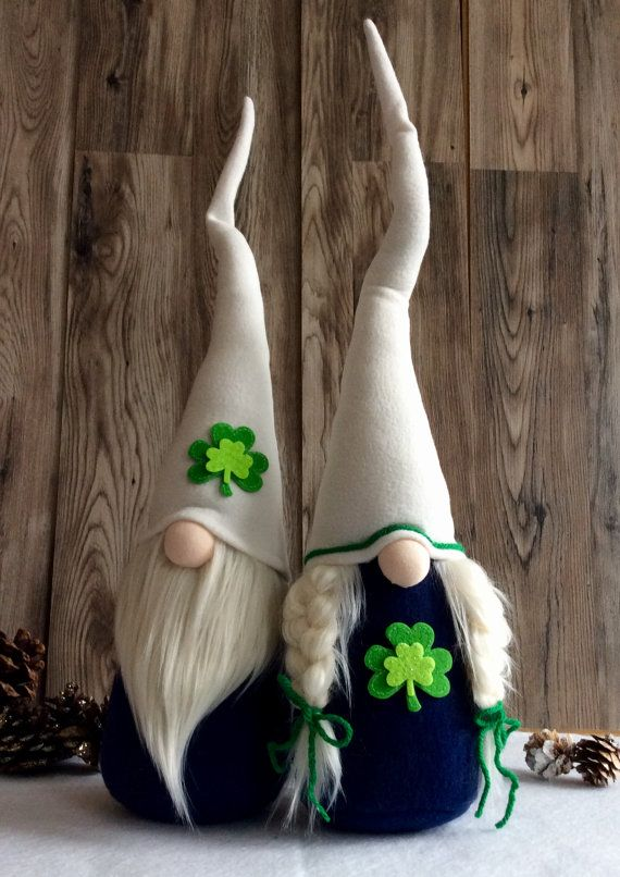 Set of two St. Patricks Day Gnomes  Clover and  Emerald  READY TO SHIP!  Features bendable hat to position any way you desire! Weighted bottom for extra stability! Each Gnome is individually handmade , every thread stitched carefully with lots of love!  ☘️Clover she has a Navy Blue body, soft white hat embellished with St. Paddys Day green ribbon, Fluffy white messy braids, and a Shamrock accent!  ☘️Emerald he has a Navy Blue body, soft white hat with green Shamrock embellishment, and a l...