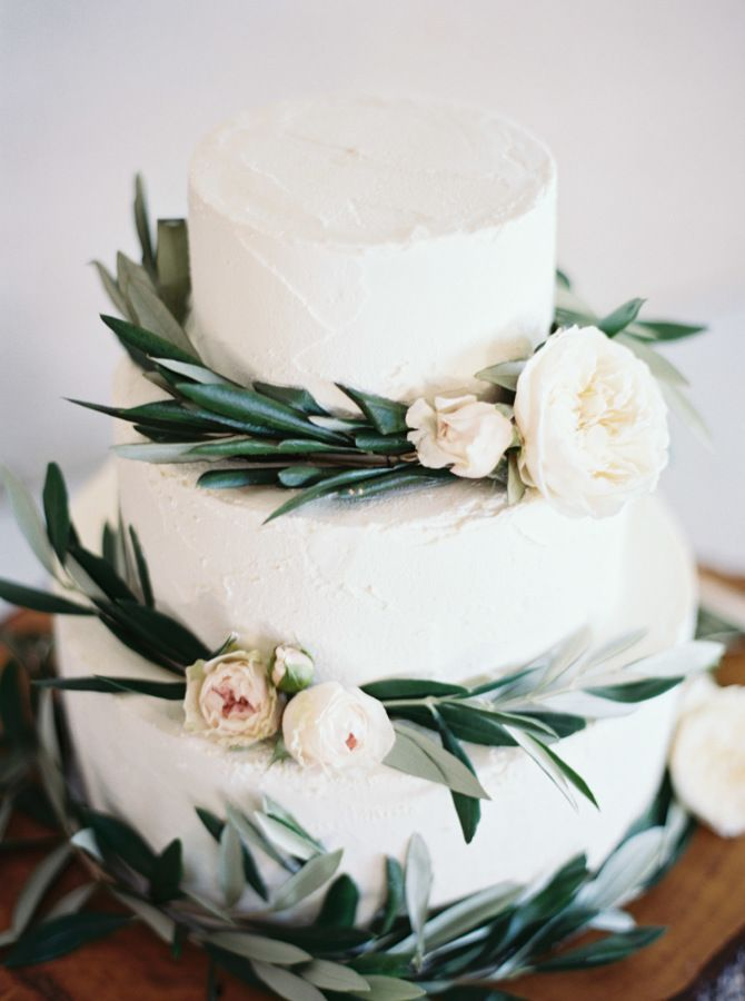 white flower and olive branch wedding cakes