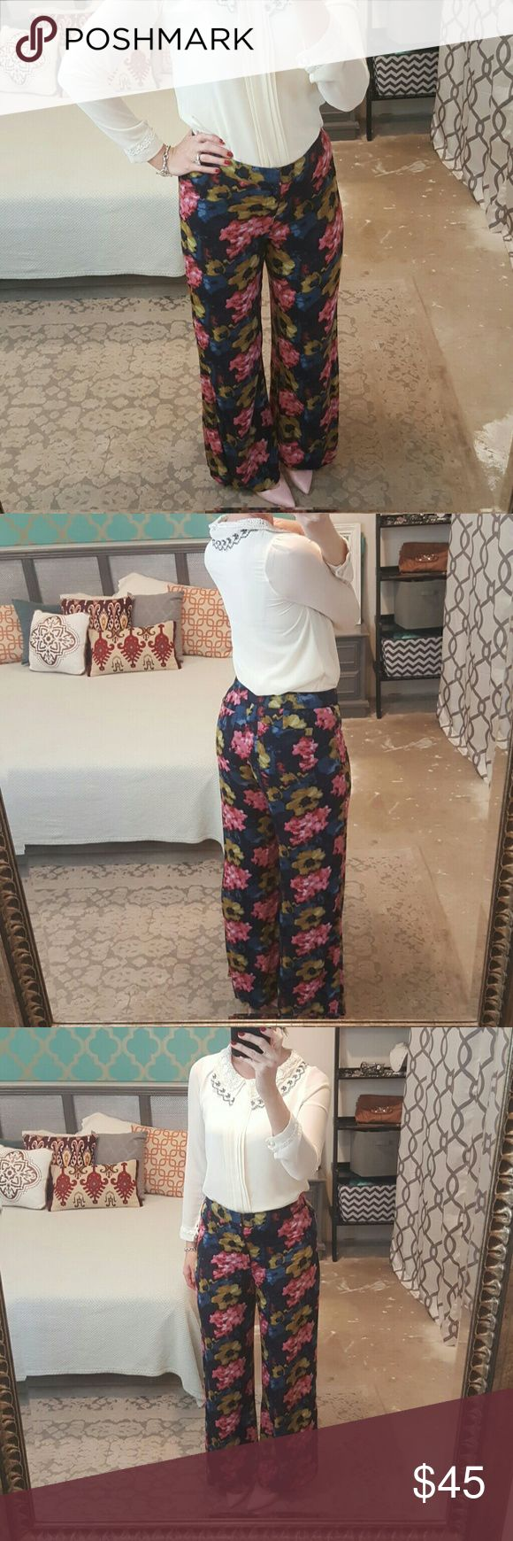 Abercrombie & Fitch Wide Leg Floral Pants I am selling a gorgeous pair of Abercrombie & Fitch wide leg trousers.  These are a stunning, flattering silhouette in a breathtaking and feminine floral print.  The color hues feature, navy blue, midnight blue, olive green, pink and very minimal touches of white.  These feel uber soft on and translate from work to play wonderfully!  Excellent condition size 10. Abercrombie & Fitch Pants Wide Leg