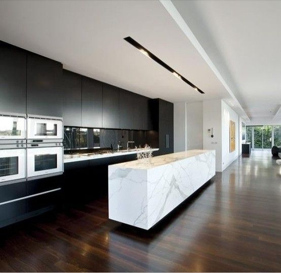 """""""wow"""" kitchen, stunning marble island / black wall cabinetry / dark floors / long clean lines"""