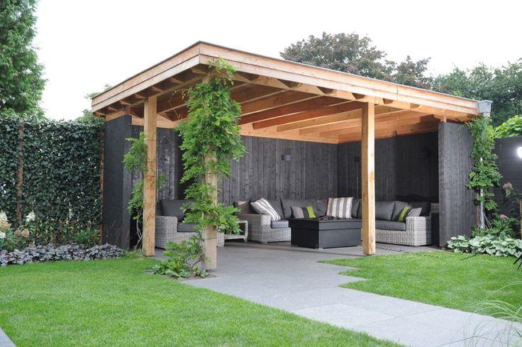 Mooi, dat grijs (bij ons zwart) vd schutting en bank en dan het dak/palen in hout.