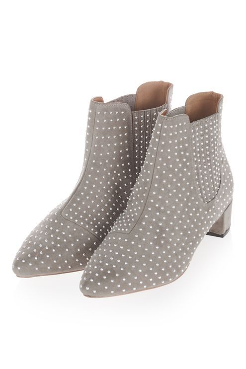 Ankle boots get an update in this edgy pair in grey with all-over stud detailing. Structured with a pointed toe, it comes with a minimal heels for a slight lift. #Topshop