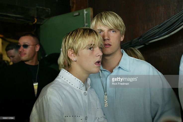 Nick Carter (R) from the Back Street Boys and his brother Aaron Carter attend the Kiss Concert at the Tweeter Center.
