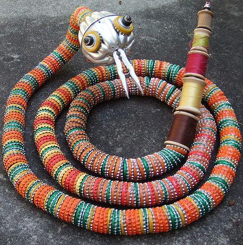 bottlecap snake  by ramona_hotel, via Flickr