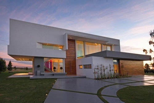Contemporary Architecture. Large white double story flat roof. Lots of glass