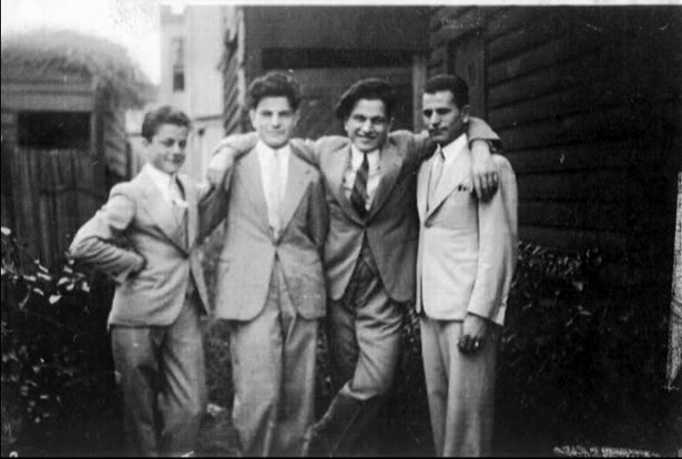 The backyard behind the original salon where they all lived. The apprentices lived in a dormitory behind the shop & went home on weekends.  L to R Maurice, Eugene, Louis & John Cordony