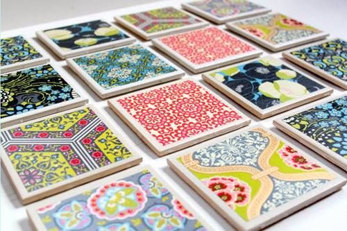 These are tile coasters made using small tile pieces and paint. Decorate them the way you like and they get ready.