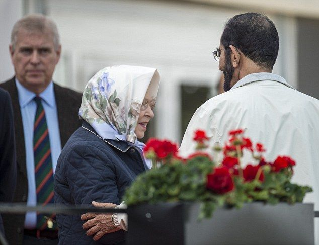 Sheikh Mohammed bin Rashid Al Maktoum placed a friendly arm on the Queen's elbow as they chatted. Andrew doesn't look impressed in the background.