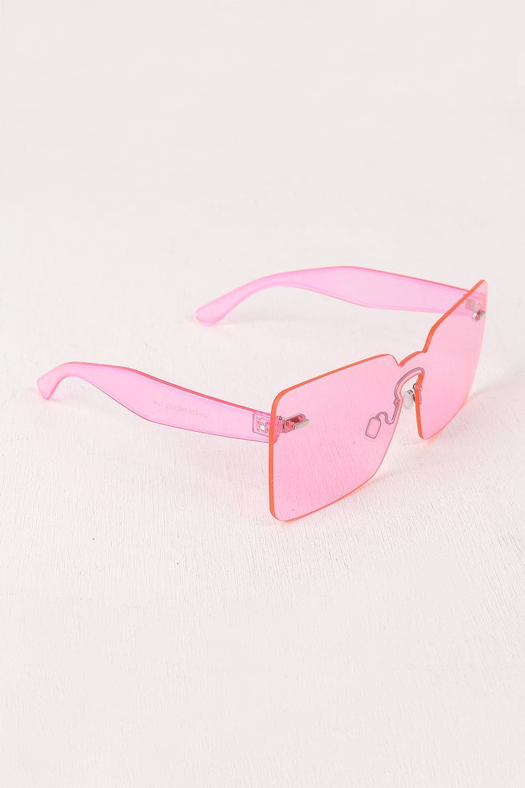 "These sunglasses feature a rectangle shape, rimless design, keyhole bridge, plastic arms, and nose pads for comfort. Measurement Measures approx. 2.1"" L x 6"" W."