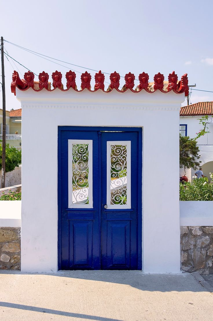 Blue door and white house on Spetses island