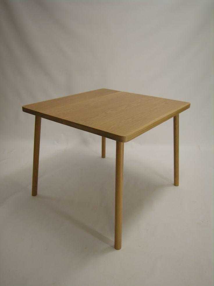 square dining table in american oak.handmade by chris colwell design